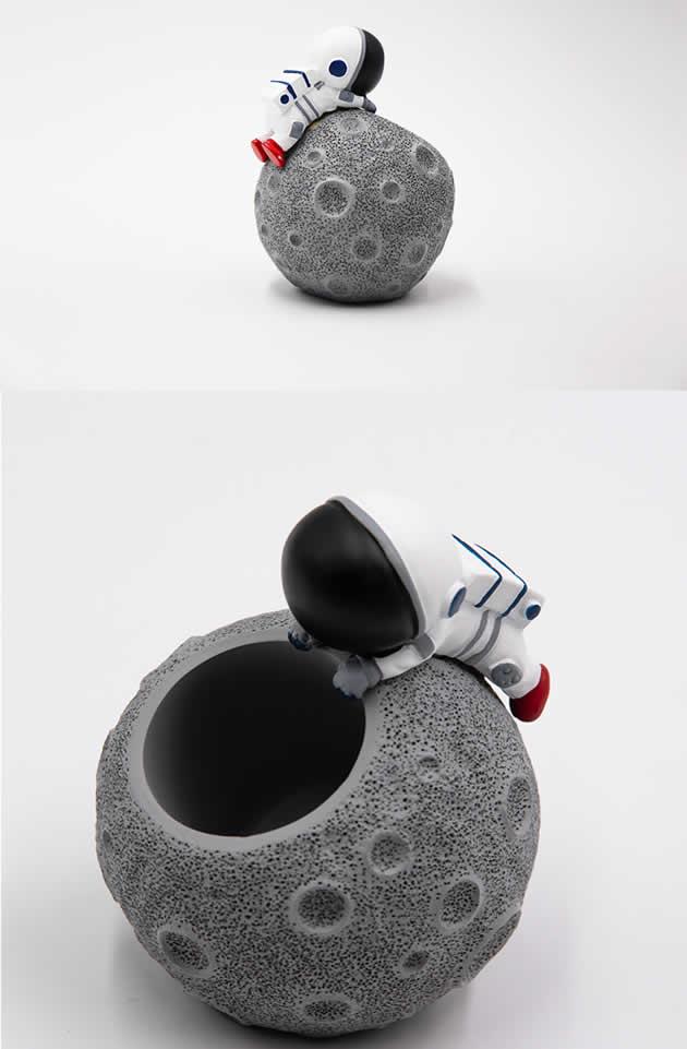 Cute cartoon astronaut with moon office desktop pen holder