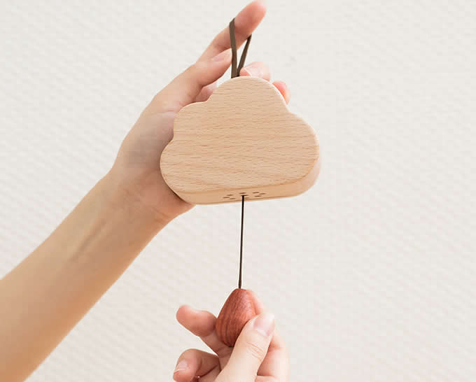 Wooden Clouds Hanging Ornament Music Box /></p> <p style=