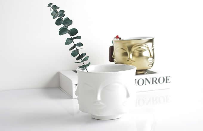 Four-Face Ceramic Vase